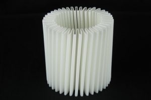 Pleated mesh filter fabric